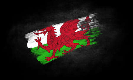smear of paint in the form of the flag of Wales close-up on a black background