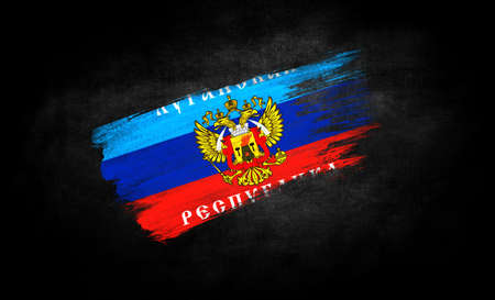 smear of paint in the form of the flag of the Lugansk People's Republic close-up on a black background Standard-Bild