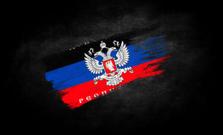 smear of paint in the form of the flag of the Donetsk People's Republic close-up on a black background Standard-Bild