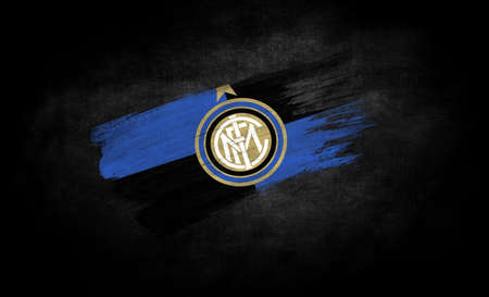smear of paint in the form of the flag of Football Club Internazionale Milano close-up on a black background