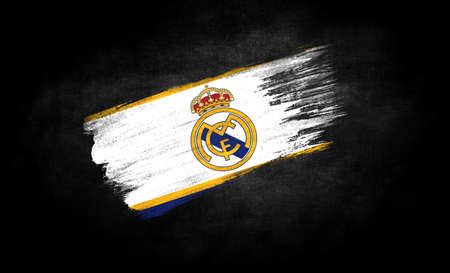 smear of paint in the form of the flag of Real Madrid close-up on a black background