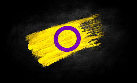 smear of paint in the form of the flag of intersex pride close-up on a black background Standard-Bild