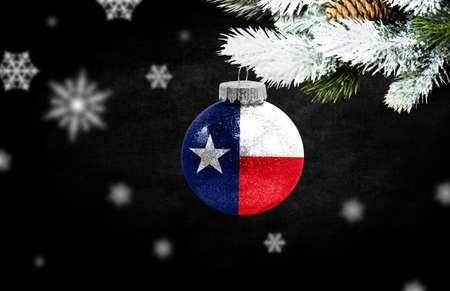 Happy new Year 2021, flag State of Texas on a christmas toy, decorations isolated on dark background. Creative christmas concept. Stock Photo