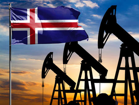 Oil rigs against the backdrop of the colorful sky and a flagpole with the flag of Iceland. The concept of oil production, minerals, development of new deposits.