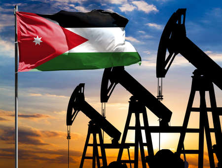 Oil rigs against the backdrop of the colorful sky and a flagpole with the flag of Jordan. The concept of oil production, minerals, development of new deposits.
