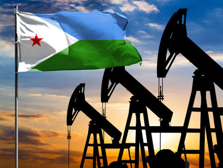 Oil rigs against the backdrop of the colorful sky and a flagpole with the flag of Djibouti. The concept of oil production, minerals, development of new deposits.