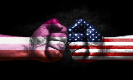 Two fists painted in the color of America and LGBT communities, a concept of confrontation. America vs Lesbian pride