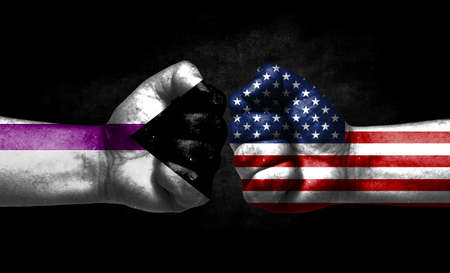 Two fists painted in the color of America and LGBT communities, a concept of confrontation. America vs Demisexual