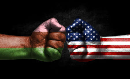 Two fists painted in the color of America and LGBT communities, a concept of confrontation. America vs Gynosexual