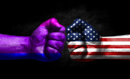 Two fists painted in the color of America and LGBT communities, a concept of confrontation. America vs Alternative Transgender pride