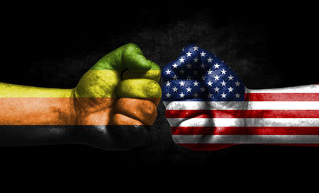 Two fists painted in the color of America and LGBT communities, a concept of confrontation. America vs Aromantic Banco de Imagens