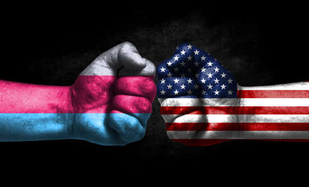 Two fists painted in the color of America and LGBT communities, a concept of confrontation. America vs Sapiosexual pride