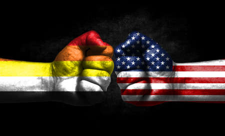 Two fists painted in the color of America and LGBT communities, a concept of confrontation. America vs Lithsexual Banco de Imagens