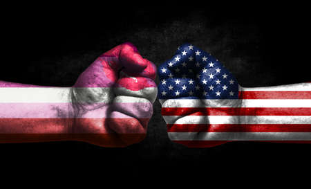 Two fists painted in the color of America and LGBT communities, a concept of confrontation. America vs Lipstick lesbian