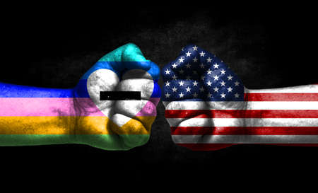 Two fists painted in the color of America and LGBT communities, a concept of confrontation. America vs Antisexual