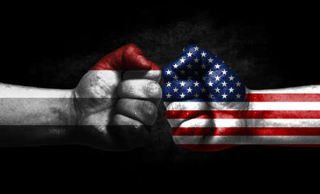 Two fists painted in the color of America and LGBT communities, a concept of confrontation. America vs Placiosexuality