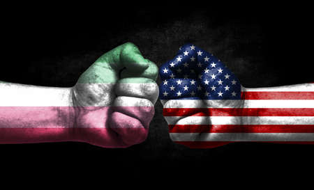 Two fists painted in the color of America and LGBT communities, a concept of confrontation. America vs Abrosexuality