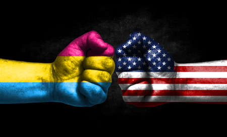 Two fists painted in the color of America and LGBT communities, a concept of confrontation. America vs Pansexuality Pride Banco de Imagens