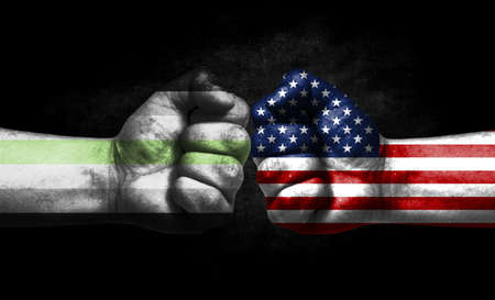 Two fists painted in the color of America and LGBT communities, a concept of confrontation. America vs Agender pride Banco de Imagens