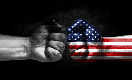 Two fists painted in the color of America and LGBT communities, a concept of confrontation. America vs Heterosexual Banco de Imagens