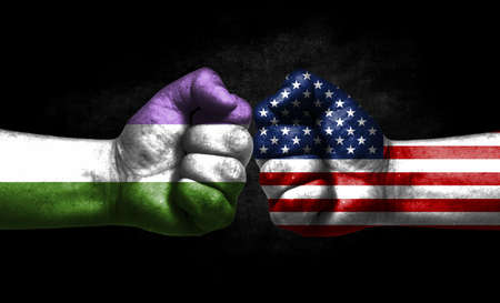 Two fists painted in the color of America and LGBT communities, a concept of confrontation. America vs Genderqueer pride