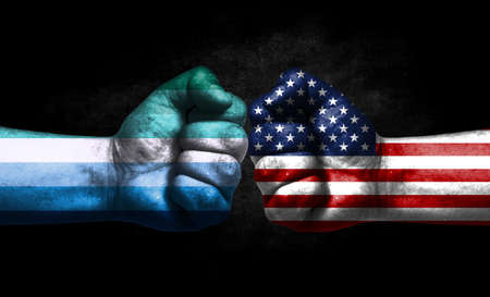 Two fists painted in the color of America and LGBT communities, a concept of confrontation. America vs Gay man