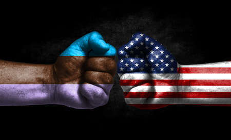 Two fists painted in the color of America and LGBT communities, a concept of confrontation. America vs Androsexual
