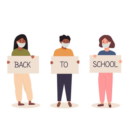 Back to school after pandemia concept. Diversity of children schoolboys and schoolgirls of different ethnicities standing together holding placard. Trendy teenagers wearing face mask with banners