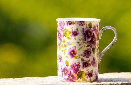 heartshaped: Purple cup on the window sill