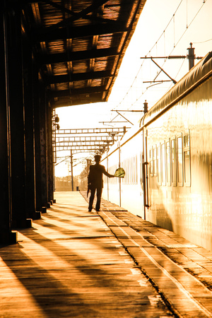 A train attendant on the platform