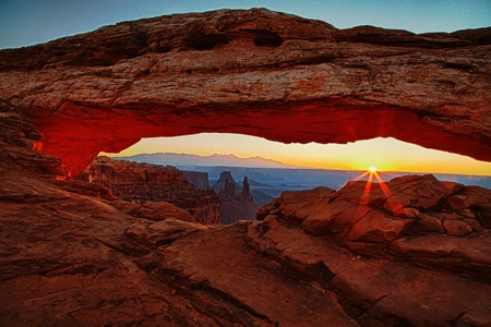 rock canyon: Mesa Arch in Canyon Lands National Park at sunrise.