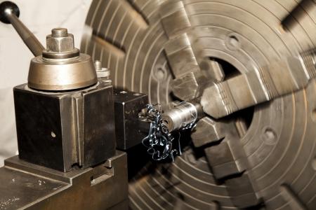 Spining Metal Lathe with metal shavings.