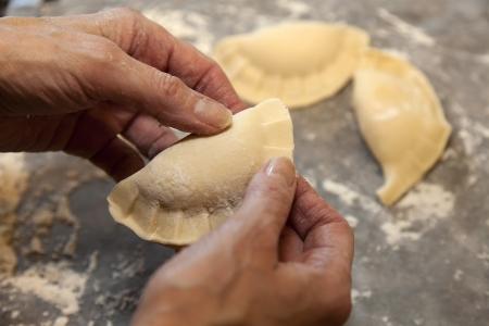 pierogi: Person preparing homemade Pierogi which is a Polish dish