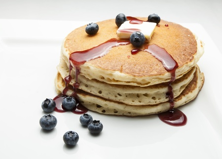 Stack of blueberry pancakes with syrup