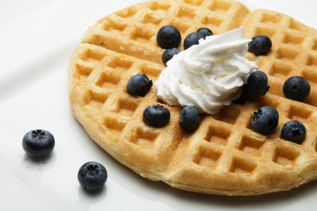Waffle with blueberries and butter,