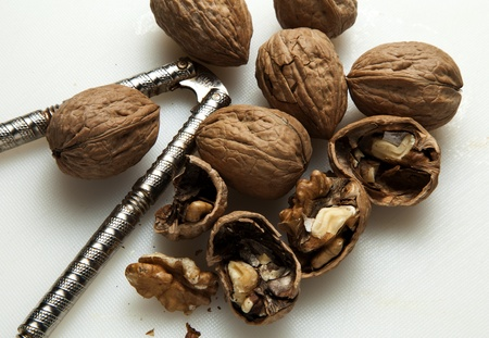 shelling: Cracking and shelling walnuts. Stock Photo