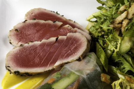 Ahi tuna that has been grilled but still raw inside