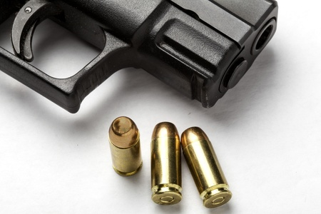 Handgun with three bullets. Stock Photo