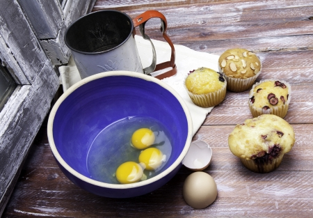 sifter: Process of baking muffins with eggs and flour sifter.