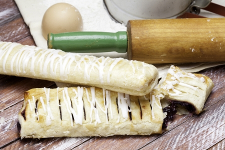 sifter: Baking pastries with rolling pin and egg shell.  Stock Photo