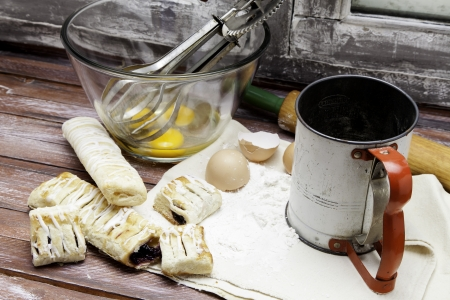 sifter: Process of baking pastries with flour sifter, eggs and bowl.
