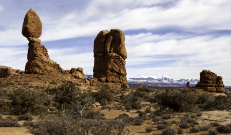 Balanced rock with the Manti La Sal mountains in Arches National Park