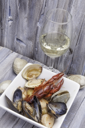 Seafood stew with a glass of white wine