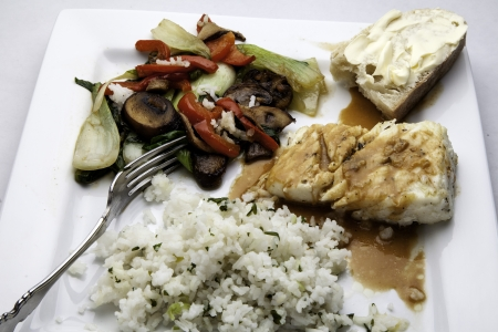 halibut: Halibut with spicy sauce and vegetables and rice