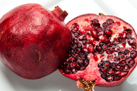 Ripe pomegranate cut in half and ready to eat  Banco de Imagens