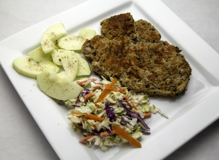 breaded pork chop: Breaded pork chop with cooked apples