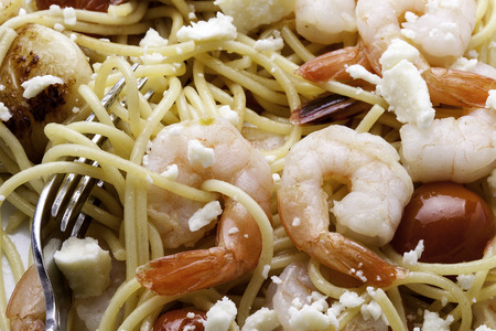 Close up view of shrimp and pasta dish