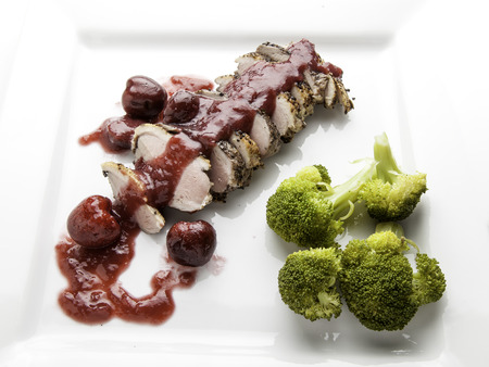 Roasted duck breast with cherry sauce and broccoli
