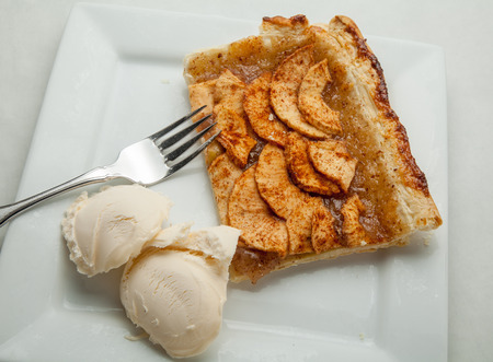 Apple tart with ice cream.