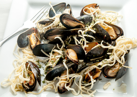 mussel: Spicy mussel and pasta dish. Stock Photo